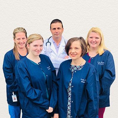 CMM Team Photo white wall - Our Team